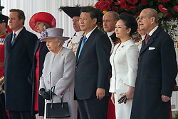 © London News Pictures 20/10/2015. Her Majesty The Queen, president Xi, his wife Peng Liyuan and the Duke of Edinburgh at Horse Guards Parade during the ceremony<br /> <br /> More than 1,100 soldiers and 230 horses joined HM The Queen, HRH The Duke of Edinburgh, The Duke and Duchess of Cornwall, the Prime Minister, Senior members of the Cabinet, the Lord Mayor of London, the Mayor of London, and the Defence Chiefs of Staff for the ceremonial welcome to Britain of The President of The People's Republic of China and Madame Peng Liyuan . Photo credit: Rupert Frere/LNP