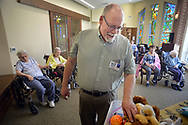 Chaplain Blaik Westhoff (cq) gathers some of the stuffed animals he uses during Spirit Alive, a religious service for people with dementia that incorporates Montessori principles Wednesday, June 28, 2017 at Meadow Glen Personal Care in Richlandtown, Pennsylvania. (WILLIAM THOMAS CAIN / For The Philadelphia Inquirer)