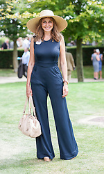 Carole Vorderman enjoys a day at the races at Glorious Goodwood, but has no luck with his bet. Image ©Licensed to i-Images Picture Agency. 31/07/2014. Chichester, United Kingdom. Glorious Goodwood. Goodwood Racecourse. Picture by i-Images