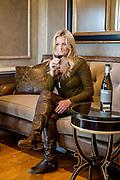 Beautiful woman wine tasting at Chalk Hill Estate Vineyard.