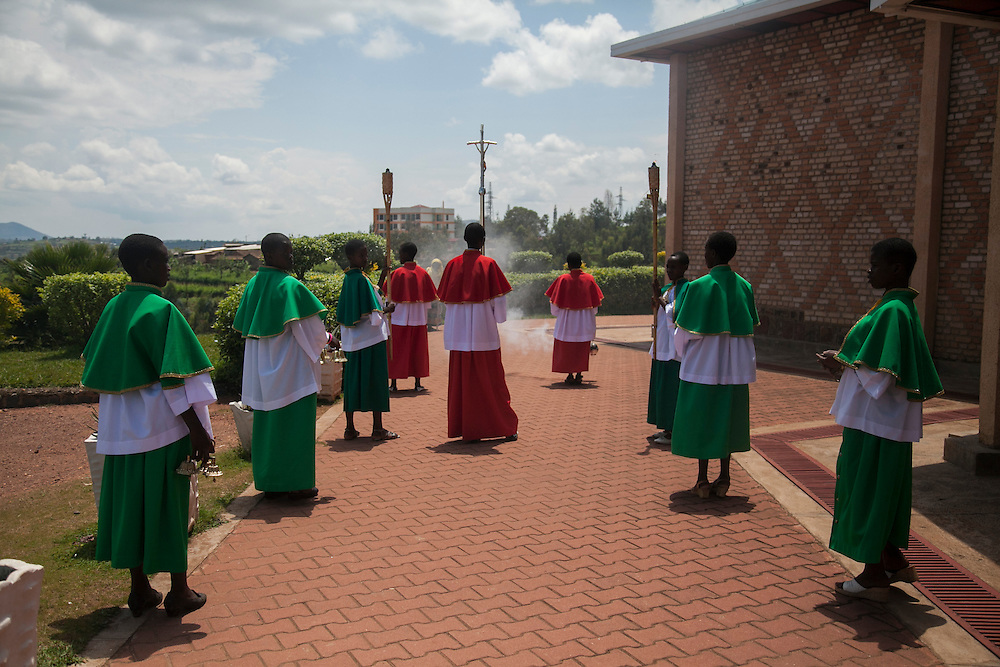 Altar servers prepare to process into mass at The Shrine of Our Lady of Sorrows in Kibeho, Rwanda. This is the only sanctioned Marian sanctuary in Africa. Kibeho's overseers and the Rwandan government hope this place will become a top tourism site. <br /> <br /> Photographed on Sunday, October 26, 2014.<br /> <br /> Photo by Laura Elizabeth Pohl