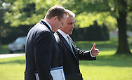 White House Press Secretary Robert Gibbs  and  White House Chief of Staff Rahm Emanuel talk as they  walk towards Marine One as President Barack Obama travels to New York City pon April 22, 2010. l photo by Dennis Brack