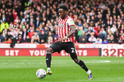 Brentford Midfielder Moses Odubajo (2) in action during the EFL Sky Bet Championship match between Brentford and Queens Park Rangers at Griffin Park, London, England on 2 March 2019.