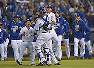Kansas City Royals catcher Salvador Perez (13) is mobbed by teammates after defeating the Los Angeles Angels in game three of the 2014 ALDS baseball playoff game at Kauffman Stadium. The Royals won 8-4 advancing to the ALCS against the Baltimore Orioles.