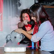 NLD/Amsterdam/20121129- Uitreiking Red's Hot Women Awards 2012, Guenevere Prawiroatmodjo doet een scheikundig proefje met stikstof
