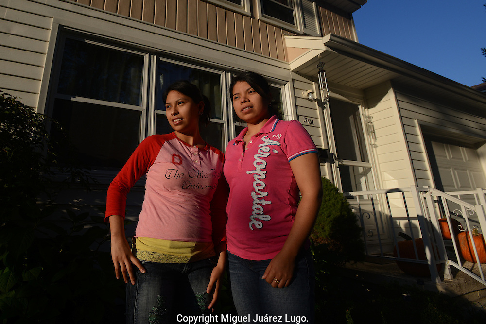 PAINESVILLE, OH - OCT. 15, 2012. The Pacheco sisters--first time voters--in front of their suburban house. María Ester, 21, and María Nancy, 25, work in a factory that makes military airplane parts. Ester became a US citizen in September this year and will vote Democrat. Nancy became a US citizen in January and also plans to vote for Obama. (Photo by Miguel Juárez Lugo)