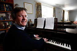 UK ENGLAND BERKSHIRE CHAPEL ROW 23MAR11 - Piano teacher Daniel Nicholls poses for a portrait at the grand piano at which he taught Kate Middleton music lessons during her childhood...jre/Photo by Jiri Rezac..© Jiri Rezac 2011
