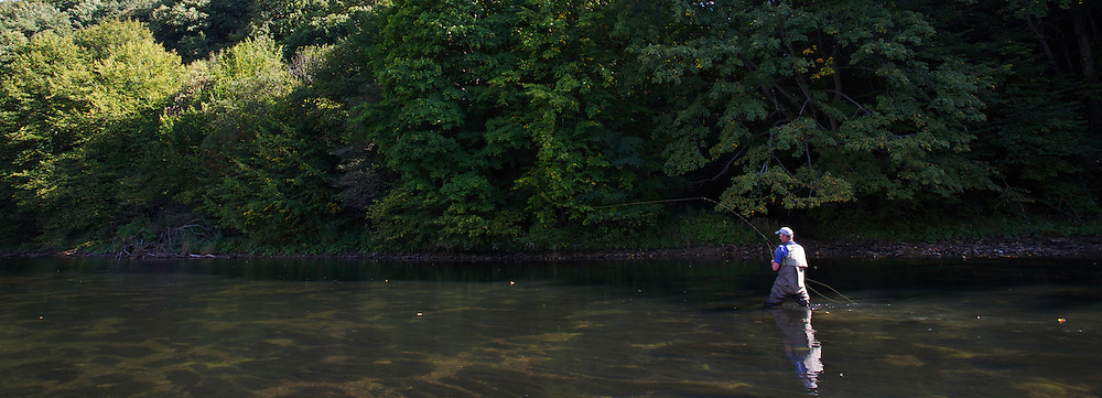 Jeremy Lucas (Pioneer Flyfishing Ltd) casting across the San River. Myczkowce, Poland.