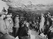 World War I 1914-1918: German soldiers listening to a concert in the safety of a French cave, 1915. Military, Soldier, Entertainment, Music