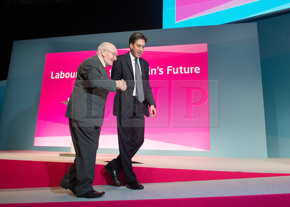 © Licensed to London News Pictures. 21/09/2014. Manchester, UK. Ed Miliband welcomes Stanley Turner from Tamworth to the stage. Labour Party Conference 2014 at the Manchester Convention Centre today 21 September 2014. Photo credit : Stephen Simpson/LNP