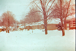 Photos taken by George Look.  Image started as a color slide.  Converted to black and white via computer software.  Dust and other artifacts may exist.<br /> <br /> Snow fall, S. Eighth Street, Pekin Illinois 1979