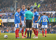 Portsmouth players surround the ref after Portsmouth midfielder Gary Roberts is sent off during the Sky Bet League 2 match between Portsmouth and Newport County at Fratton Park, Portsmouth, England on 12 March 2016. Photo by Adam Rivers.