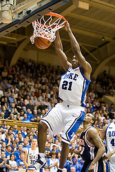 Duke guard DeMarcus Nelson (21) dunks against Virginia.  The Duke Blue Devils defeated the Virginia Cavaliers 87-65 in men's basketball at Cameron Indoor Stadium on the campus of Duke University in Durham, NC on January 13, 2008.