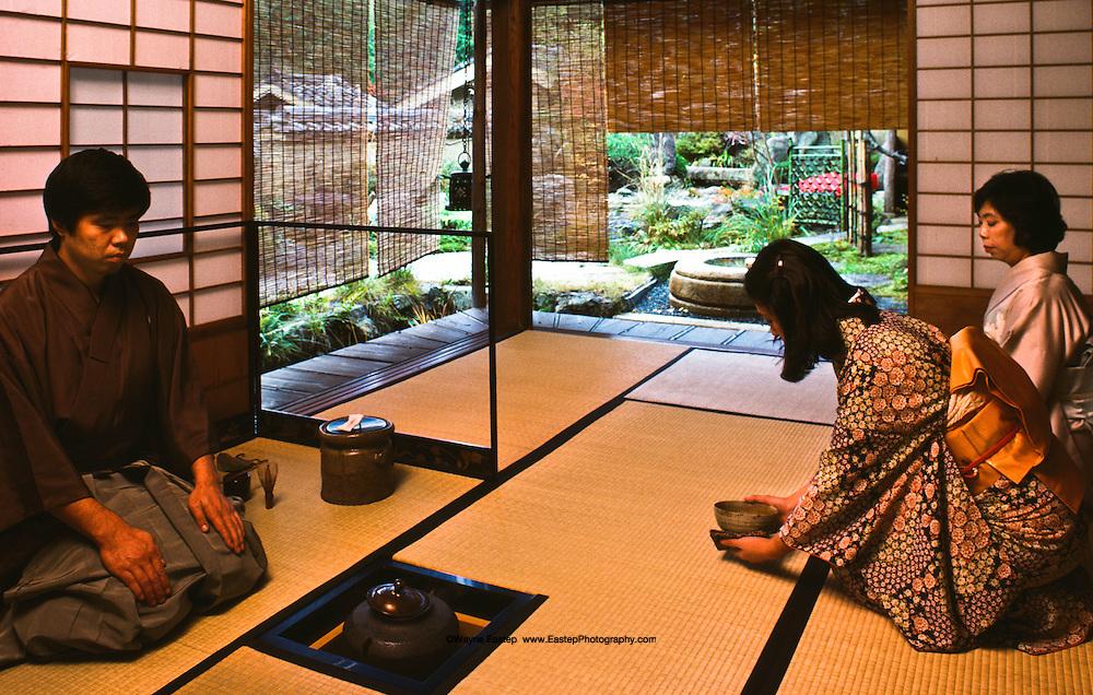Nobotokean tea ceremony,tea master Ueda Roshiro, near guest Sachiko Matsumoto, guest in background Michiko Ueda Kyoto, Japan