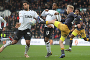 Sheffield Wednesday midfielder Barry Bannan challenges Derby County midfielder Tom Huddlestone with a high tackle during the EFL Sky Bet Championship match between Derby County and Sheffield Wednesday at the Pride Park, Derby, England on 9 March 2019.