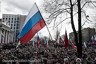 Ukraine, Donetsk. Pro-Russia supporters stand in front of the prosecution Office in Donetsk right before storm it. Demonstrators demand that prosecutor Nikolaj Frantovski to go out, outside the prosecution office where police take security precautions. Frantovski (not pictured) goes out and speaks to the crowd but demonstrators raise the Russian flag and break the windows of the prosecution officeALESSIO ROMENZI