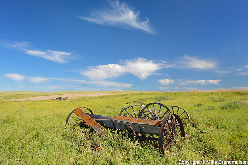 Old  farm equipment on abandonned farm , Near Monchy, Saskatchewan, Canada