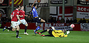 Rai Simons negotiates the keeper during the The FA Cup match between FC United of Manchester and Chesterfield at Broadhurst Park, Manchester, United Kingdom on 9 November 2015. Photo by Pete Burns.