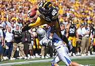 September 4 2010: Iowa Hawkeyes tight end Allen Reisner (82) leaps over Eastern Illinois Panthers safety Carlos Reyna (6) after a catch during the third quarter of the NCAA football game between the Eastern Illinois Panthers and the Iowa Hawkeyes at Kinnick Stadium in Iowa City, Iowa on Saturday September 4, 2010. Iowa defeated Eastern Illinois 37-7.