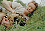 Boy lying in the grass with his dog