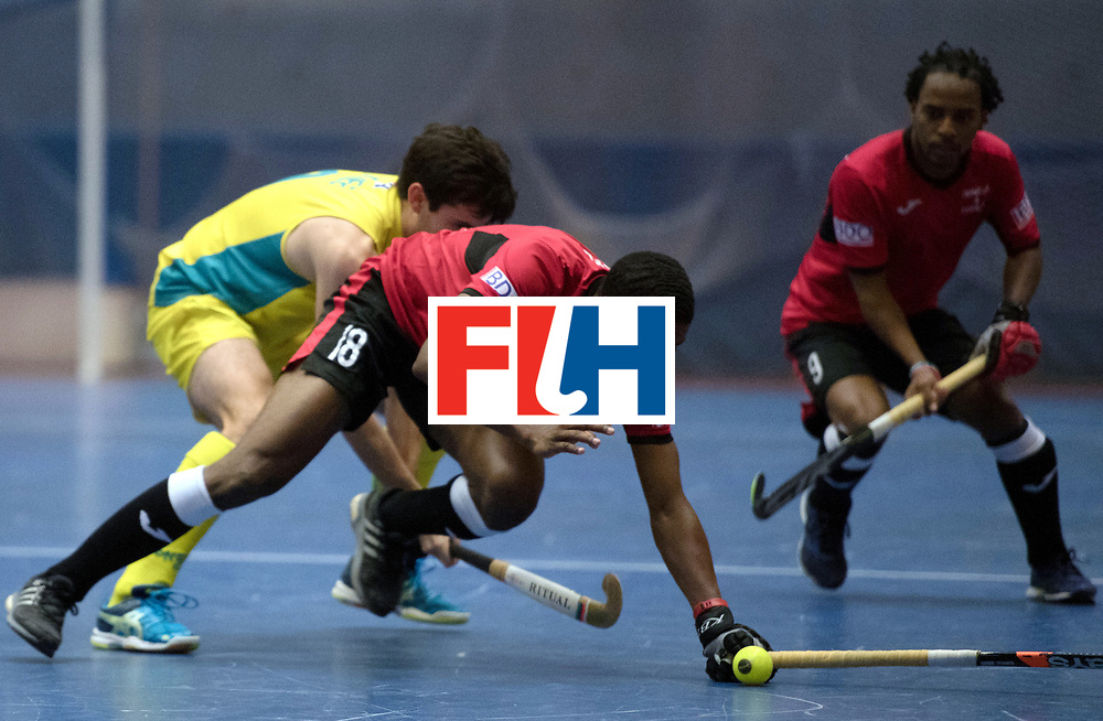 BERLIN - Indoor Hockey World Cup<br /> Trinidad &amp; Tobago - Australia<br /> foto: Mickell Pierre <br /> WORLDSPORTPICS COPYRIGHT FRANK UIJLENBROEK