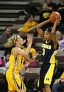 26 JANUARY 2009: Michigan guard Veronica Hicks (3) tries to pass the ball over Iowa guard Kristi Smith (11) during the first half of an NCAA women's college basketball game Monday, Jan. 26, 2009, at Carver-Hawkeye Arena in Iowa City, Iowa. Iowa defeated Michigan 77-69.