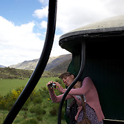 Nina Schneider, 23, from Germany, photographing from the Kingston Flyer vintage steam train at Saturday's relaunch of the historic locomotives at Fairlight near Queenstown, Central Otago, New Zealand, 29th October 2011. Photo Tim Clayton...