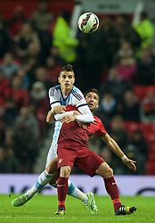 MANCHESTER, ENGLAND - Tuesday, November 18, 2014: Argentina's Erik Lamela in action against Portugal's Joao Moutinho during the International Friendly match at Old Trafford. (Pic by David Rawcliffe/Propaganda)