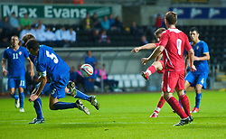 SWANSEA, ENGLAND - Friday, September 4, 2009: Wales' Aaron Ramsey scores the second goal against Italy during the UEFA Under 21 Championship Qualifying Group 3 match at the Liberty Stadium. (Photo by David Rawcliffe/Propaganda)