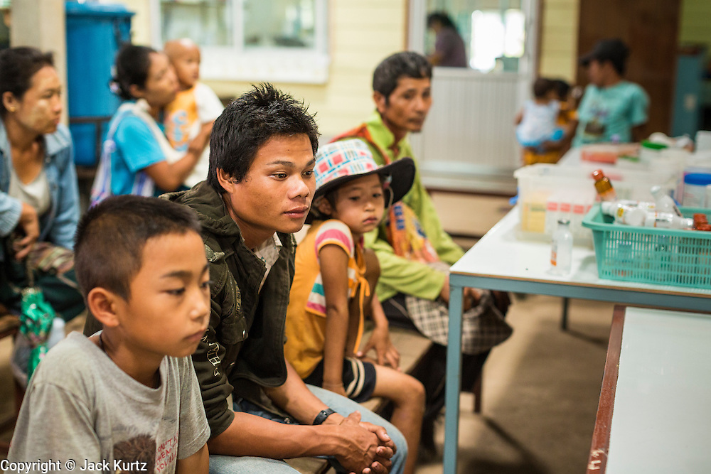 20 MAY 2013 - MAE KASA, TAK, THAILAND:  Burmese patients in the pharmacy waiting area at the SMRU clinic in Mae Kasa, Thailand. The clinic is less than 50 meters from the Thai-Burma border and sees only Burmese patients. Thais go to Thai government hospitals. Health professionals are seeing increasing evidence of malaria resistant to artemisinin coming out of the jungles of Southeast Asia. Artemisinin has been the first choice for battling malaria in Southeast Asia for 20 years. In recent years though,  health care workers in Cambodia and Myanmar (Burma) are seeing signs that the malaria parasite is becoming resistant to artemisinin. Scientists who study malaria are concerned that history could repeat itself because chloroquine, an effective malaria treatment until the 1990s, first lost its effectiveness in Cambodia and Burma before spreading to Africa, which led to a spike in deaths there. Doctors at the Shaklo Malaria Research Unit (SMRU), which studies malaria along the Thai Burma border, are worried that artemisinin resistance is growing at a rapid pace. Dr. Aung Pyae Phyo, a Burmese physician at a SMRU clinic just a few meters from the Burmese border, said that in 2009, 90 percent of patients were cured with artemisinin, but in 2010, it dropped to about 70 percent and is now between 55 and 60 percent. He said the concern is that as it becomes more difficult to clear the parasite from a patient, progress that has been made in combating malaria will be lost and the disease could make a comeback in Southeast Asia.    PHOTO BY JACK KURTZ
