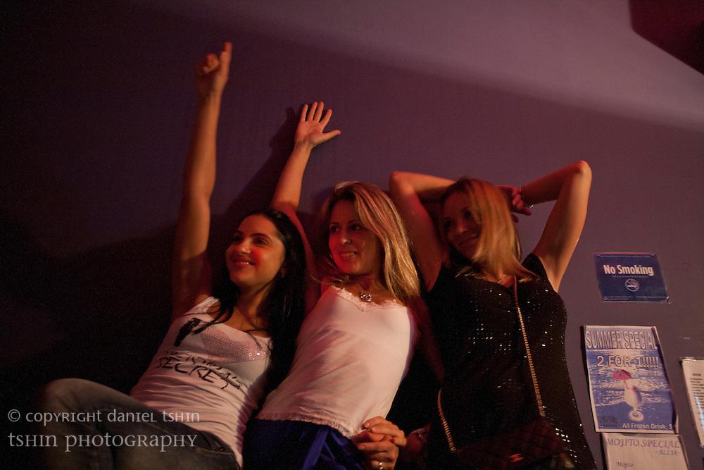 Having a karaoke blast with friends in a Karaoke dive in Alphabet City