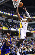Feb. 28, 2012; Indianapolis, IN, USA; Indiana Pacers small forward Danny Granger (33) shoots the ball over Golden State Warriors shooting guard Monta Ellis (8) at Bankers Life Fieldhouse. Indiana defeated Golden State 102-78. Mandatory credit: Michael Hickey-US PRESSWIRE