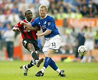 Photo: Scott Heavey.<br />Leicester City v Manchester City. FA Barclaycard Premiership. 24/04/2004.<br />Ben Thatcher cant stop the shot from Shaun Wright Phillips