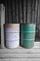 2 colored barrels on a loading dock