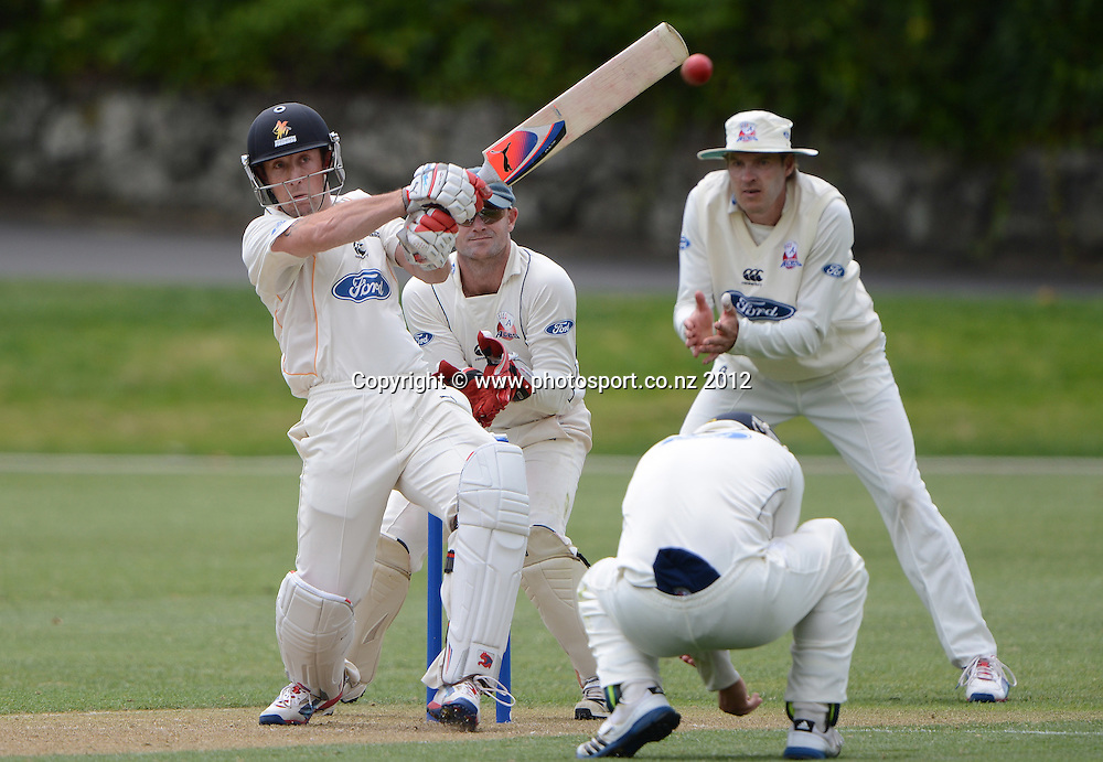 Wellington's Luke Ronchi pulls as Auckland keeper Gareth Hopkins looks on. Plunket Shield Cricket, Auckland Aces v Wellington Firebirds at Eden Park Outer Oval. Auckland on Monday 26 November 2012. Photo: Andrew Cornaga/Photosport.co.nz