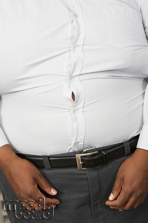 Overweight man wearing tight shirt, mid section