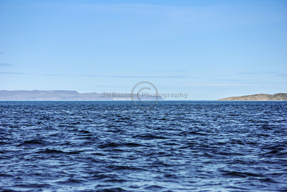 Ivujivik, Qc. July 2011- Picture on the Digges sound looking towards the North. The island on the left side of the picture in the horizon is Digges Island, home to a colony of millions of Thick-billed Murres
