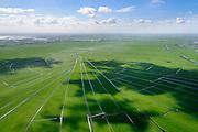 Nederland, Noord-Holland, Gemeente Ouder-Amstel, 09-04-2014; Amstelland, Polder de Rondehoep (ook Polder de Ronde Hoep), een van de grootste onbebouwde weidegebieden van de Randstad met karakteristiek stervormig kavelpatroon. Dit slotenpatroon van gerende verkaveling is ontstaan ten tijde van de ontginning in de middeleeuwen. Vinkenveense Plassen aan de horizon.<br /> The Polder Rondehoep (or Polder Round Hoep), one of the largest undeveloped pasture area's in the Randstad with characteristic star-shaped pattern. This pattern is the result of the extraction during the Middle Ages.<br /> luchtfoto (toeslag op standard tarieven);<br /> aerial photo (additional fee required);<br /> copyright foto/photo Siebe Swart