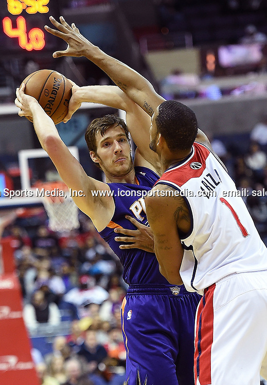 March 26, 2014 - Washington, DC, USA - Phoenix Suns guard Goran Dragic (1) is pressured by Washington Wizards forward Trevor Ariza (1) during the first half of their game played at the Verizon Center in Washington, Wednesday, Mar. 26, 2014