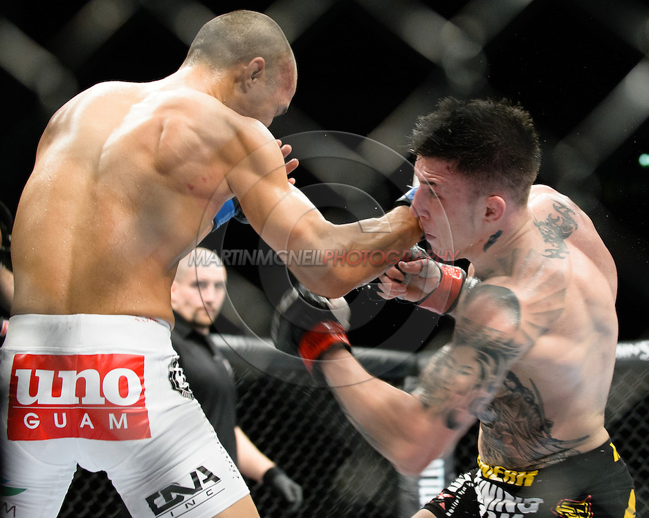 "MANCHESTER, ENGLAND, OCTOBER 26, 2013: Norman Parke (black shorts) and Jon Tuck (white trunks) compete during ""UFC Fight Night 30: Machida vs. Munoz"" inside Phones4U Arena in Manchester, England (© Martin McNeil)"