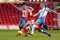 Photo: Leigh Quinnell.<br /> Nottingham Forest v Swindon Town. Coca Cola League 1. 25/02/2006. Notingham Forests Nathan Tyson finds his way through Swindons Sean O'Hanlon and Jerel Ifil.