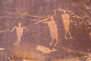 Petroglyphs of flute players in Shay Canyon on public BLM land, near Monticello, Utah, USA.