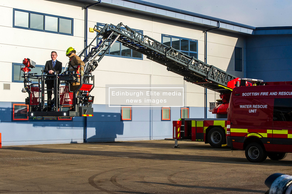 Pictured: Derek Mackay and turn table ladder crew leader Pete Emmerson<br /> Today Finance Secretary Derek Mackay visit the Scottish Fire and Rescue Services' East HQ in Edinburgh ahead of a meeting with other finance ministers  on VAT costs. During his tour of the facilities, the Finance Secretary spoke to firefighters and staff prior to hosting the Finance Ministers Quadrilateral where he will raise the issue of the GBP35 million annual VAT cost faced by Scottish police and fire services in contrast to other territorial police and fire services in the UK.<br /> <br /> Ger Harley   EEm 14 February 2017