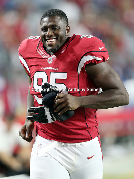 Arizona Cardinals rookie defensive tackle Rodney Gunter (95) laughs as he jogs off the field after the 2015 NFL preseason football game against the San Diego Chargers on Saturday, Aug. 22, 2015 in Glendale, Ariz. The Chargers won the game 22-19. (©Paul Anthony Spinelli)