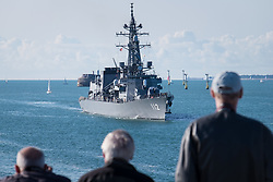 © Licensed to London News Pictures. 25/08/2018. Portsmouth, UK.  People welcoming the 151-metre long destroyer JS Makinami (112) from the Japanese Maritime Self Defense Force (JMSDF) arriving in Portsmouth this morning, 25th August 2018.  This vessel and the 143-metre long cadet training vessel JS Kashima (3508) have recently conducted a passing exercise (PASSEX) with Standing NATO Maritime Group One (SNMG1) in the Baltic Sea. The ships will moor alongside in Portsmouth Naval Base and be opened to visitors over the bank holiday weekend until 28th August 2018. Photo credit: Rob Arnold/LNP