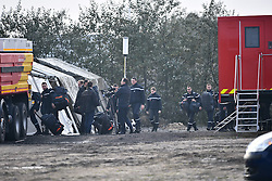 © Licensed to London News Pictures. 23/10/2016. Calais, France. Police reinforcements begin to arrive at a newly constructed police base, as preparations begin for the demolition of the migrant camp in Calais, France, known as the 'Jungle'. French authorities have given an eviction order to thousands of refugees and migrants living at the makeshift living area of the French coast. Photo credit: Ben Cawthra/LNP