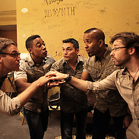 The House Jacks, consisting of Deke Sharon, Elliott Robinson, John Pointer, Austin Willacy and Nick Girard, warm up backstage prior to a performance at Freight & Salvage Coffeehouse on Saturday Dec. 1, 2012 in Berkeley, California.  The House Jacks is a professional a cappella quintet from the Bay Area, founded in 1991.  (AP Photo/Alex Menendez)