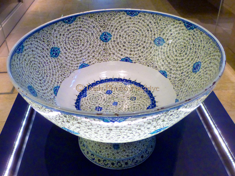 Basin with 'Golden Horn' Design, Turkey, probably Iznik.  About 1545.  This basin is decorated with tight concentric scrolls in black, which bear tiny leaves and flowers. Design named 'Golden Horn' because examples excavated near the inlet in Istabbul known as the Golden Horn,