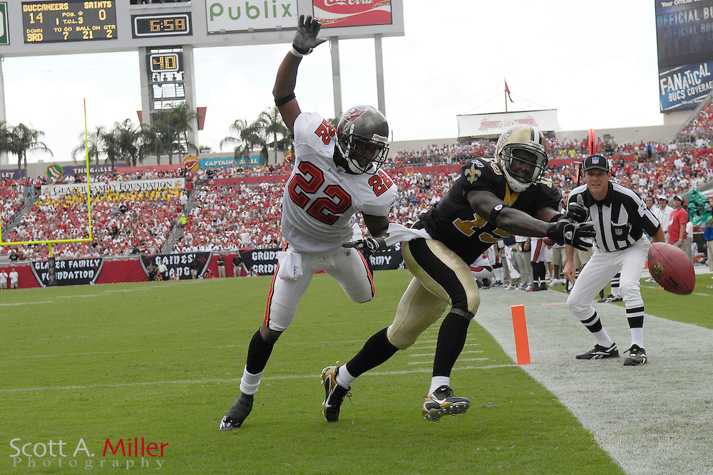 Sep 16, 2007; Tampa, FL, USA; Tampa Bay Buccaneers defender (22) Sammy Davis breaks up a pass intended for New Orleans Saints receiver (19) Devery Henderdson during the second quarter at Raymond James Stadium.Mandatory Credit: Scott A. Miller-US PRESSWIRE..©2007 Scott A. Miller