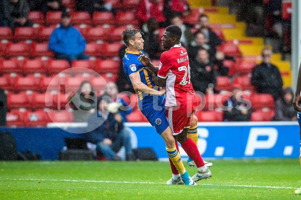 Amadou Bakayoko of Walsall is blocked by Mat Sadler of Shrewsbury Town during the EFL Sky Bet League 1 match between Walsall and Shrewsbury Town at the Banks's Stadium, Walsall, England on 7 October 2017. Photo by Darren Musgrove.